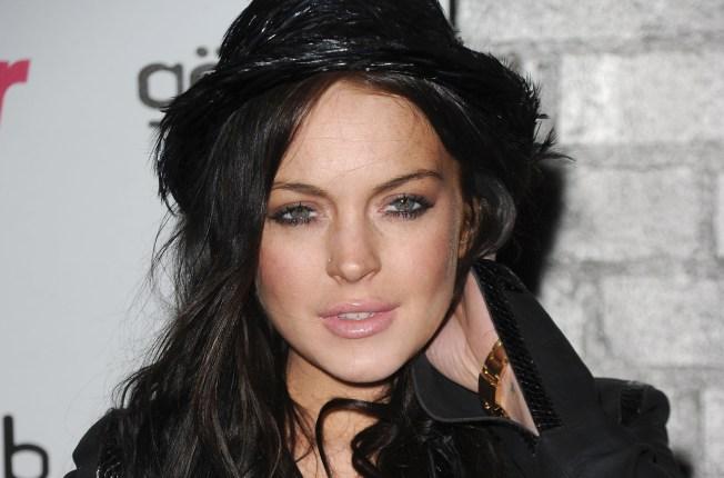"Lindsay Lohan Defends Racy Gun Photos as ""Art"""