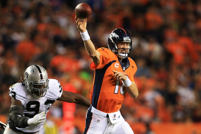 Manning and Broncos Overwhelm Raiders