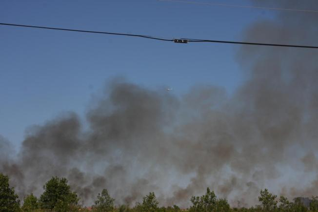 Firefighters Battle Fires in Hot Conditions