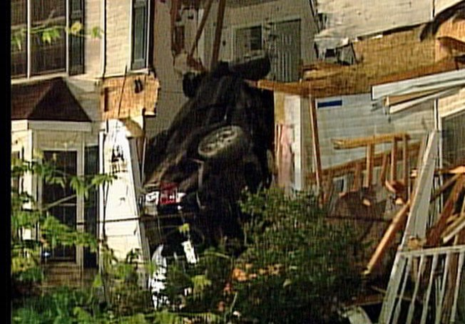 Flying SUV Slams Into Home's Second Story