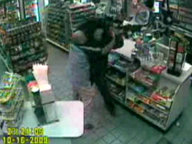 Cashier Fights off Rifle-Toting Robber