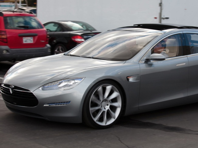 Reckless Tesla Driver Costs Startup Spandex-Clad Friends