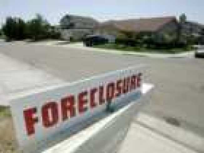 Scam Artists Target Foreclosure Victims