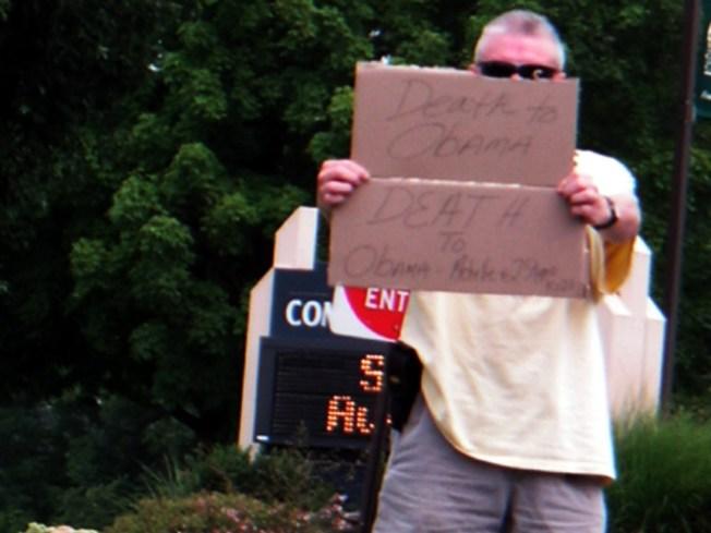 """Death to Obama"" Sign Holder Detained by Secret Service"