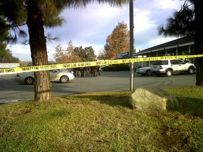 Body Found Lying Next to Lexus in Parking Lot