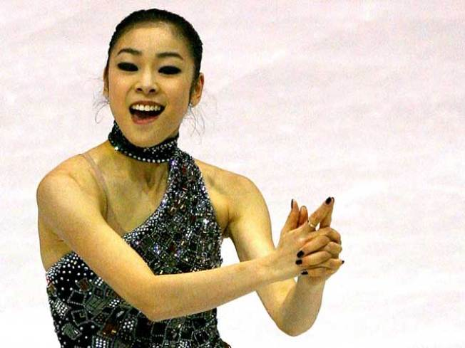 Kim Yu-na Takes Lead After Canadian's Emotional Skate
