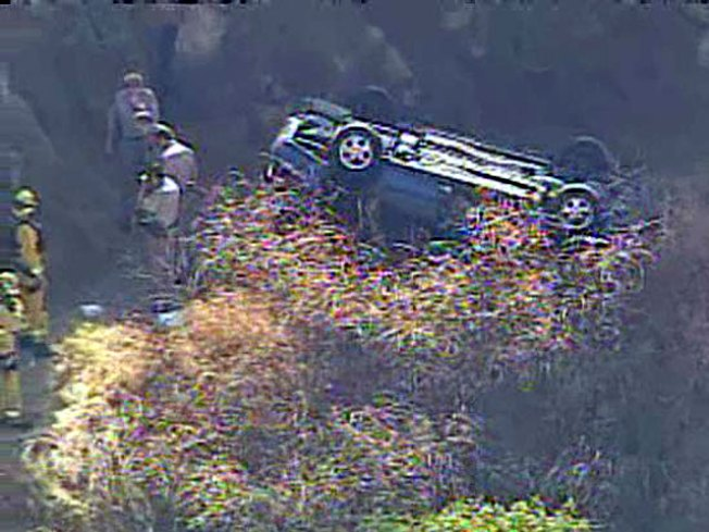 Car Into Ravine May Be Homicide