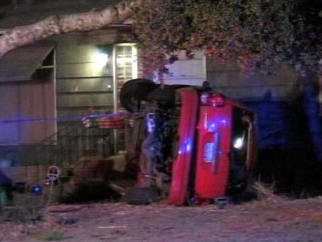 SUV Crashes in Santee Yard