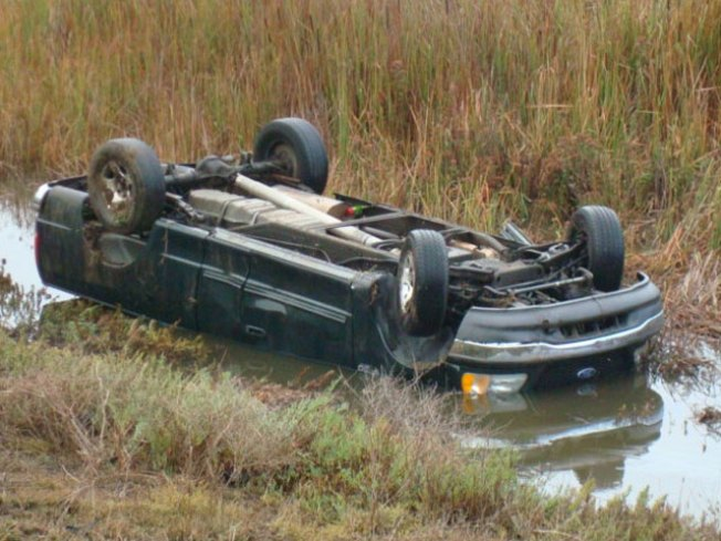 Woman Pulled From Submerged Car