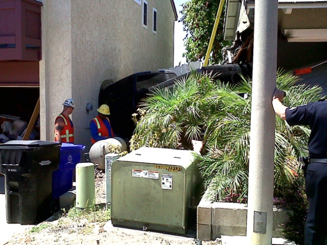 Pickup Plows into Homes in Coincidence Crash