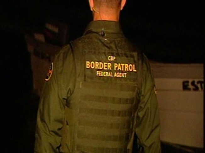 Agents Search Gated Community for Suspected Immigrants