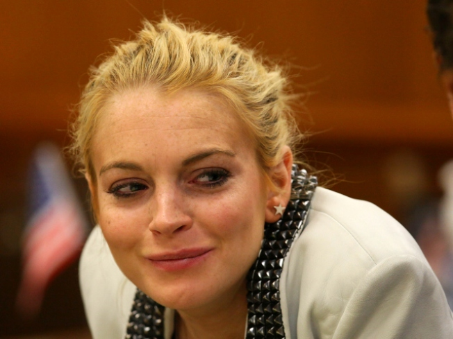 Lindsay Lohan Spars With 'Ex-Father' On Twitter
