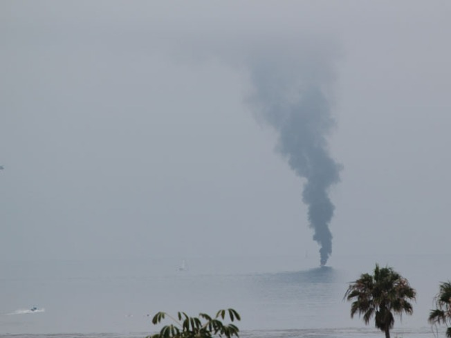 Two Escape Burning Boat