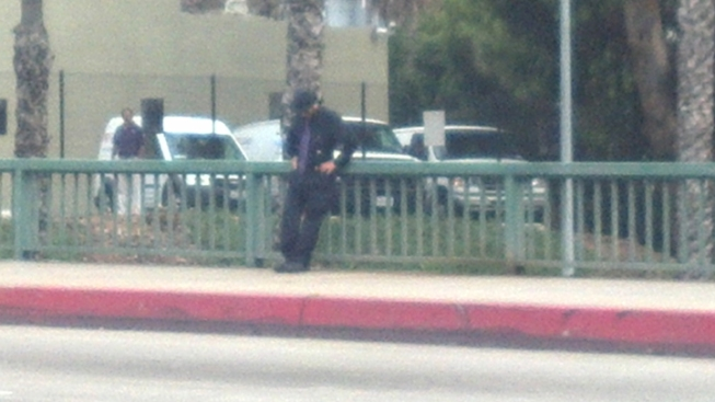 Police Negotiate With Man Standing Over SR-163