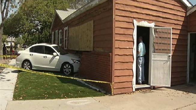 Woman Crashes Car into Home: Talmadge