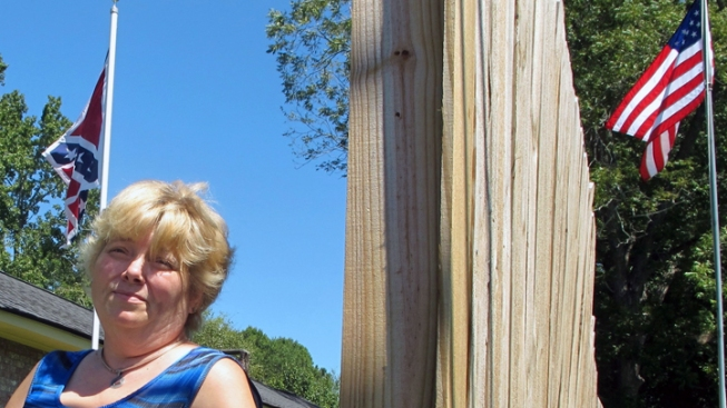 Neighbors Build 8-Foot Fences to Hide Woman's Confederate Flag