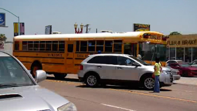 SUV Collides With Packed School Bus