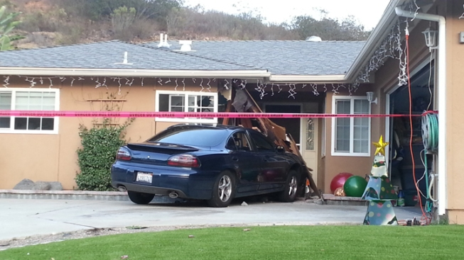 Man Rams Car into Neighbor's House
