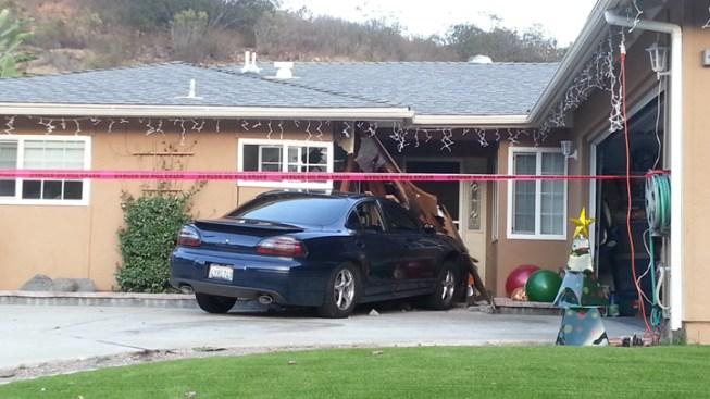 Man Rams Car into Neighbor's House