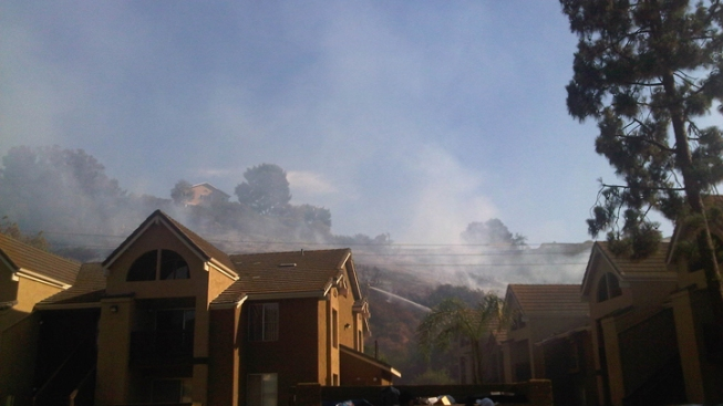 Crews Contain Fire Burning Near Homes