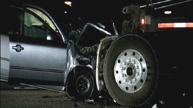 Car Crashes into Dump Truck