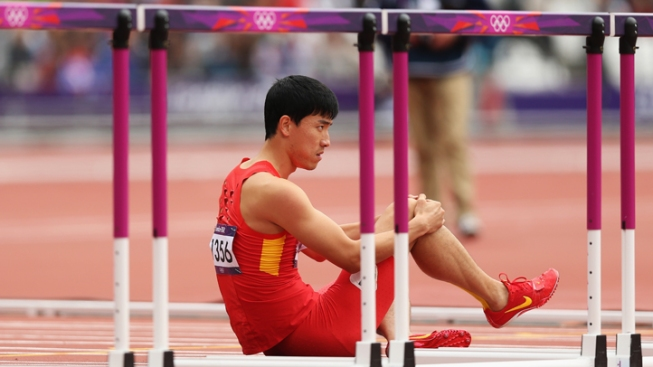China's Track Star Liu Crashes on 1st Hurdle, Out Again