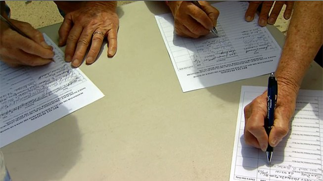 Volunteers Gather Signatures to Recall Mayor Filner