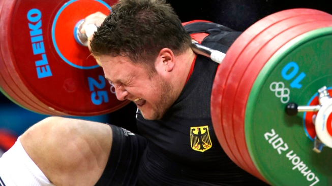 Defending Olympic Weightlifting Champion Hit by Barbell, Withdraws From Competition