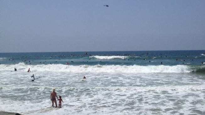"Woman Rescued from Seau's ""Paddle Out"""