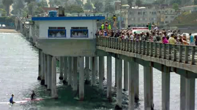 Lifeguard Recruits Jump Off OB Pier
