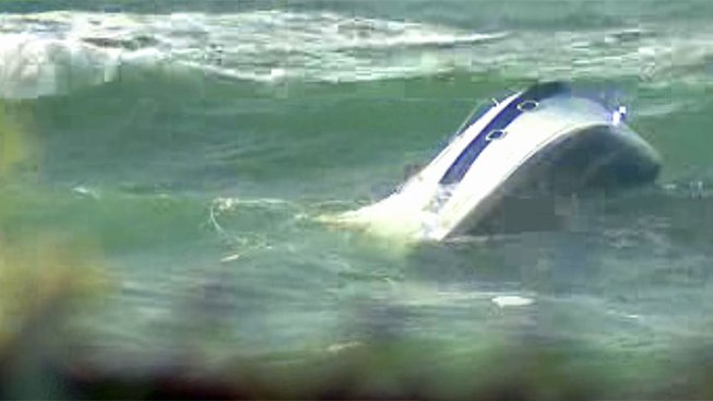 Boaters Rescued from Capsized Vessel