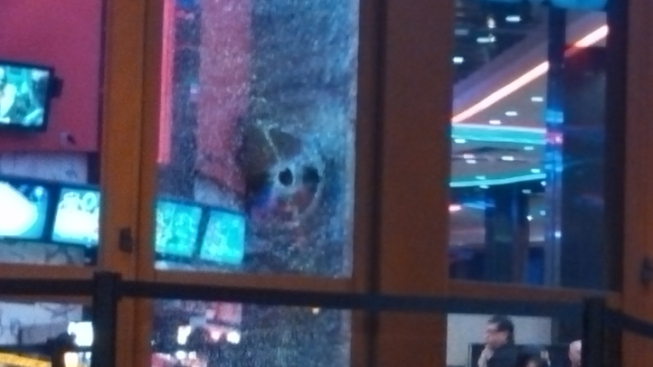 Round Fired Through Movie Theater Window