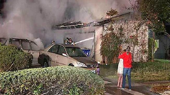 Neighbors, Cop Rescue Woman from Burning Home