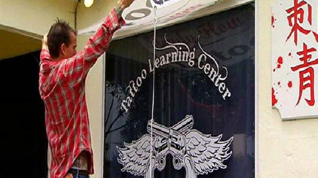 Tattoo Artists Protest New School
