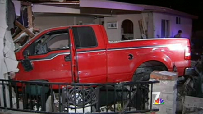 Group Flees After Crashing Truck into House