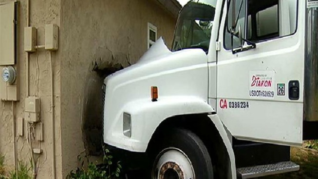 Furniture Delivery Truck Slams Into House