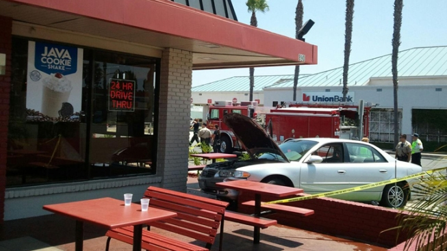 Car Slams into Jack in the Box Building