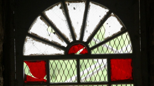 Vandals Defecate on Church Pulpit, Break Windows