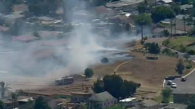 Fire Burning Behind Mobile Home Park