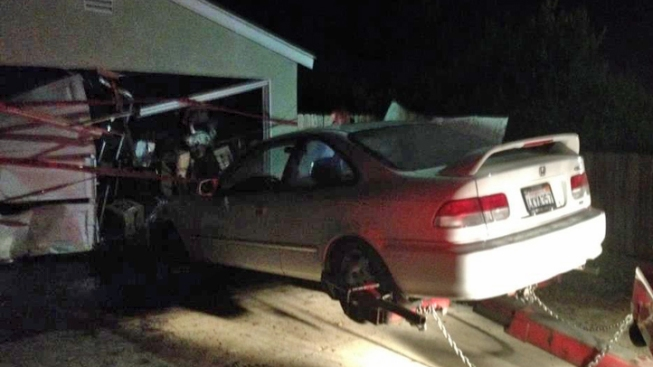 Stolen Car Slams Into Garage