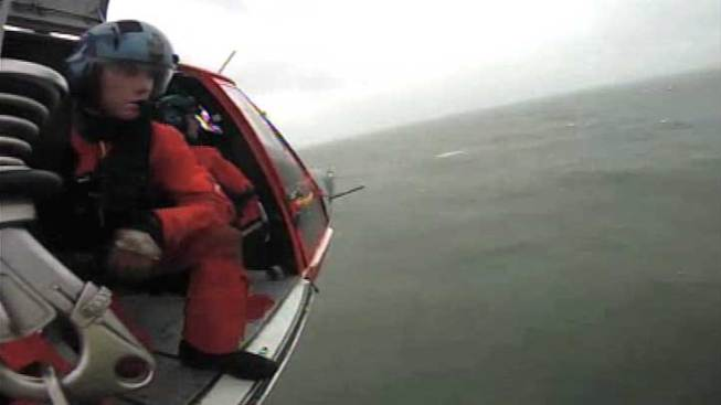 Man and His Dog Rescued from Stranded Boat