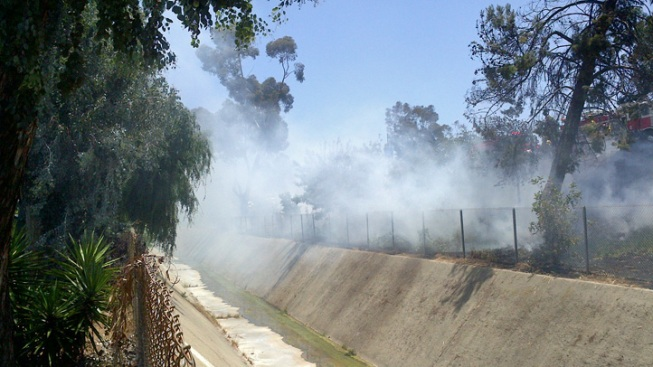Brush Fire Burning Near Highway