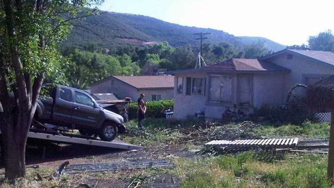 2 Injured After Car Slams House