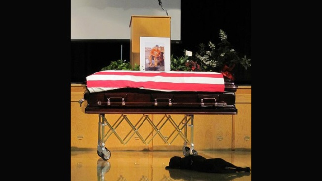 Dog Stays by Fallen Master's Side During Funeral