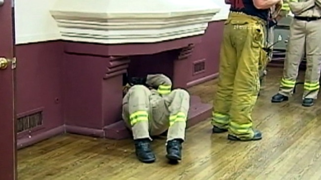 Firefighters Rescue Soot-Covered 911 Caller Stuck in Chimney