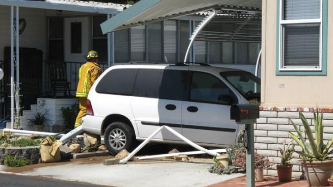 Van Crashes Into Mobile Home
