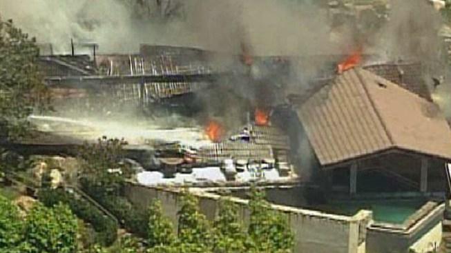 Flames Damage Vista Home