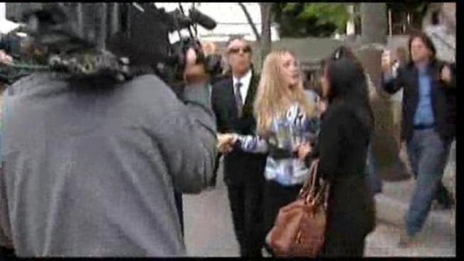 Charlie Sheen's estranged wife visits the downtown LA courthouse.