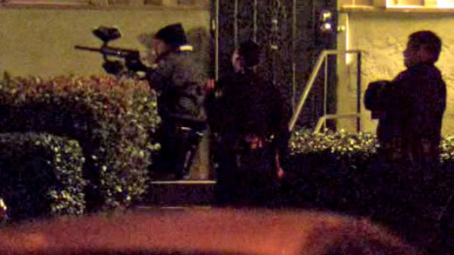 A man armed with two swords exited the apartment on Dominguez Way after a six-hour standoff with law enforcement officers. NBC 7's Brandi Powell reports.