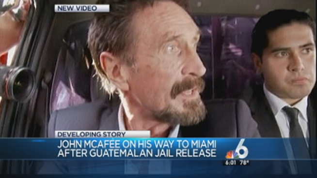 Internet entrepreneur John McAfee was escorted by Guatemalan immigration officials to the Guatemala City airport before he flew to Miami on Wednesday. Journalists crowded around the vehicle of McAfee, who Belizean officials say is wanted for questioning in the slaying of an American expatriate.
